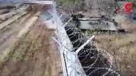 وحشت از یک تانک در خیابان های شهر / تانک دیوار فرودگاه را شکافت! + فیلم