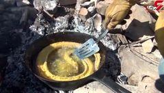 لحظه سوخاری کردن مار برای خوردن! +فیلم